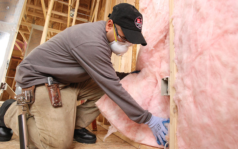 residential insulation contractors at work installing insulation