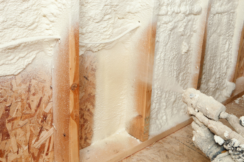 home insulation companies contractors at work applying spray foam insulation