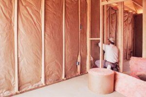 installing-insulation-into-wall-of-new-home-74065310-580f7e0b3df78c2c739b6833